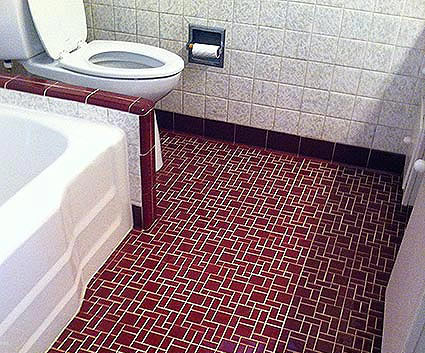 Tile flooring in a bathroom after being professionally cleaned.